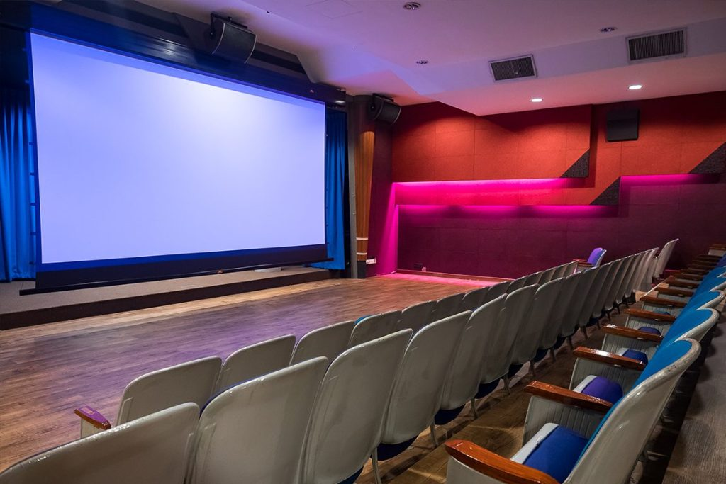 singapore mini function room with big screen and wall lights