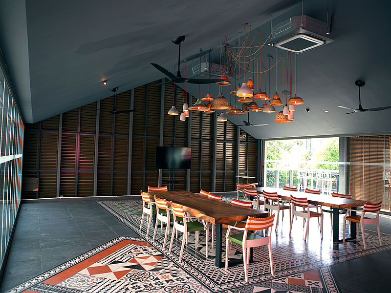 high ceiling wedding venue in singapore with wooden long table