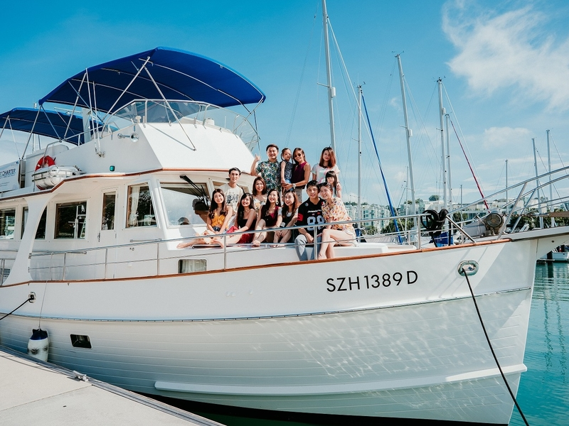 A big yacht with a big family seated on the deck