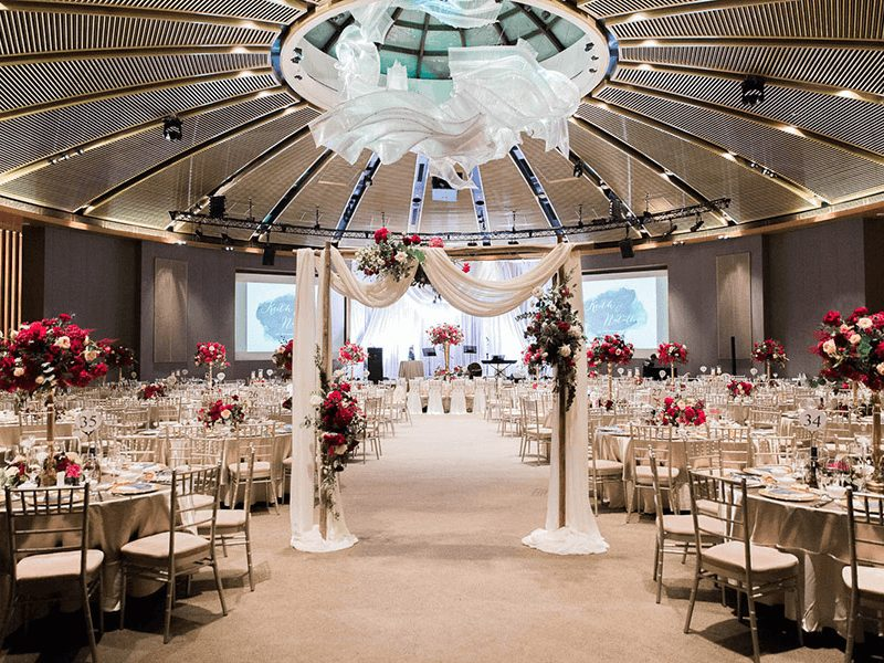 bright ballroom with floral arrangements
