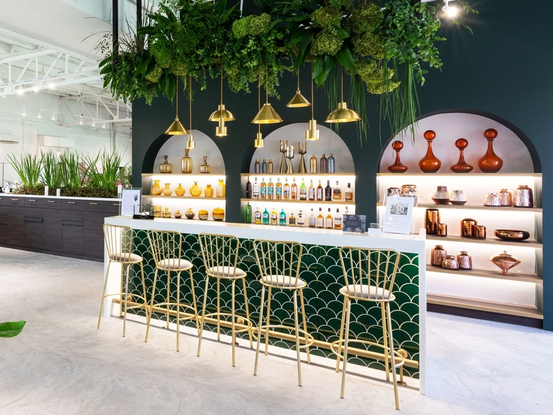 singapore event space with mini bar and golden pendant lamps