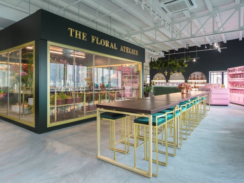 product launch venue in singapore with green interior and high-long table