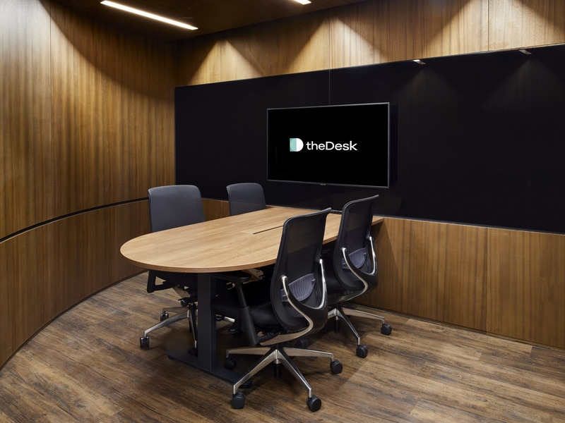 private meeting room featuring wooden interior and tv screen on the wall