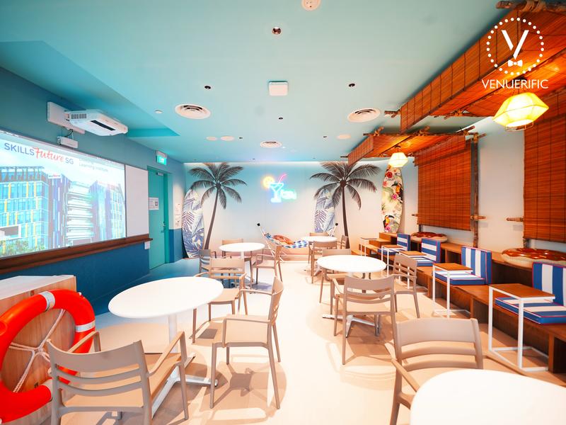 beach theme seminar venue in singapore with projector screen