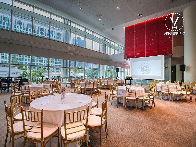 singapore convention hall with white banquet seating and large glass wall