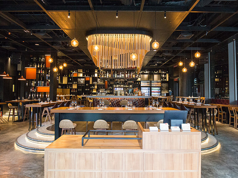 singapore modern style restaurant with yellow pendant lights