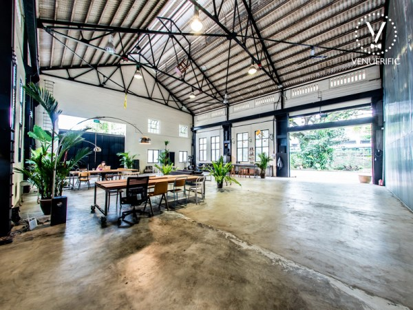 rustic venue with a lot of green plants inside and outside