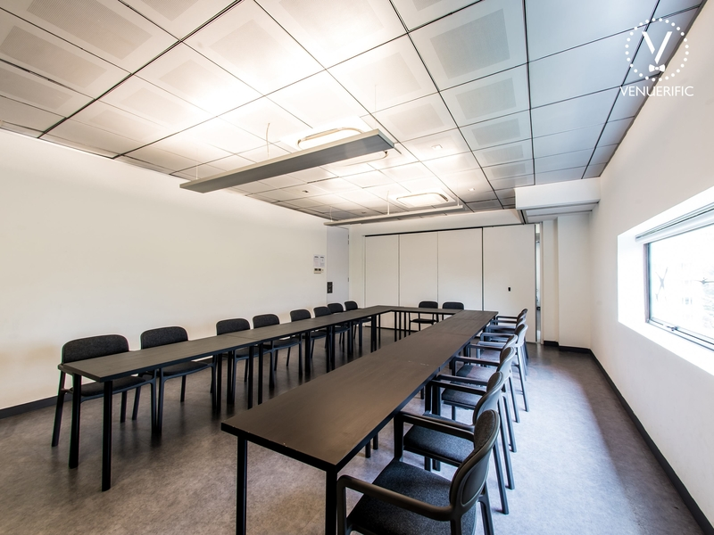 singapore meeting room with u-shaped table and white interior