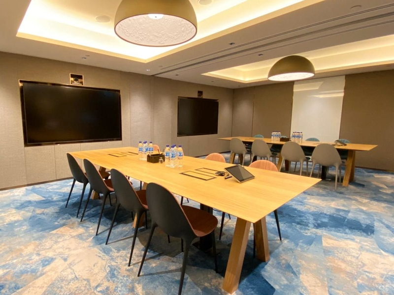 meeting space in singapore with two tables and blue floors
