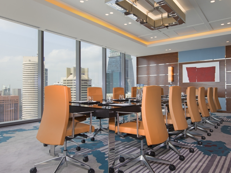 sky level meeting room with singapore city view