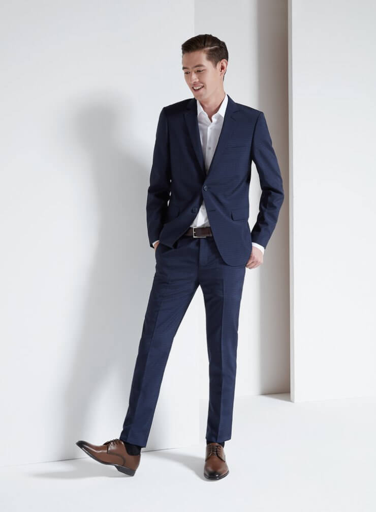 man wearing a suit and tie outfit