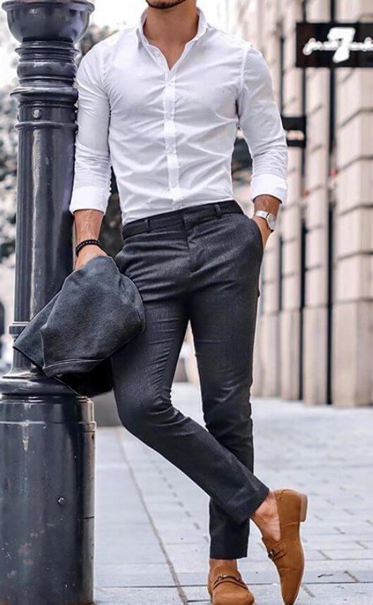 man in white shirt and dark pants
