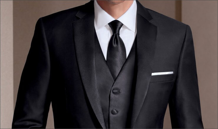 man dressed in formal suit and tie