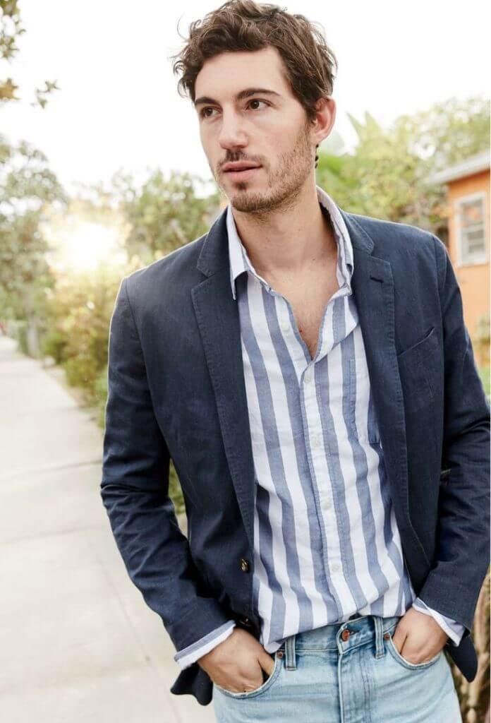 man wearing striped shirt and blue pants