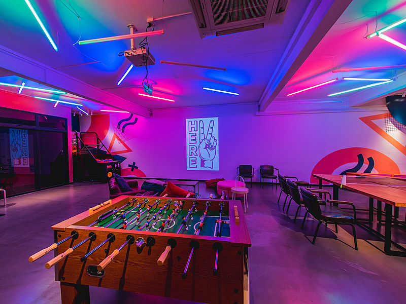Room with neon moody lights and foosball table