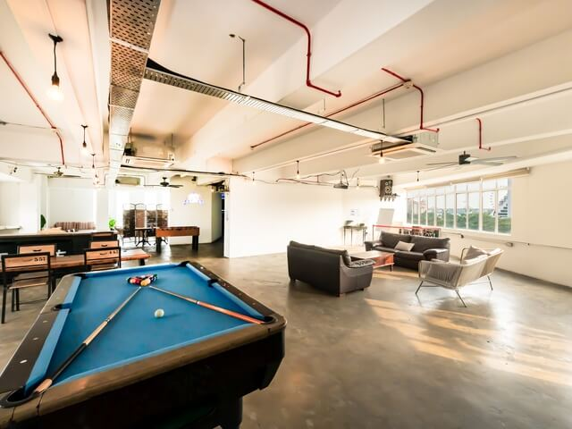 wide space with pool table and sofa