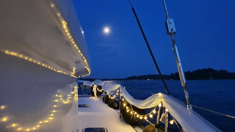 boat decked up with fairy lights for solemnisation