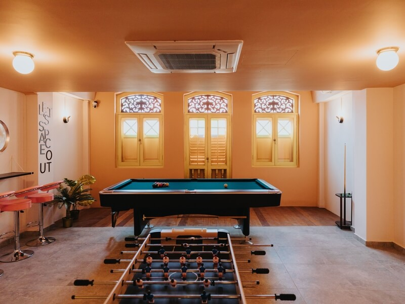 party space with pool and foosball table
