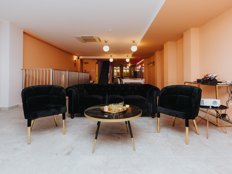 Event space with lush black couches for seating