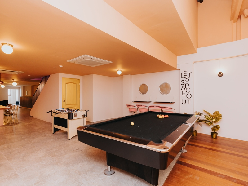 Event space with pool table and orange interiors