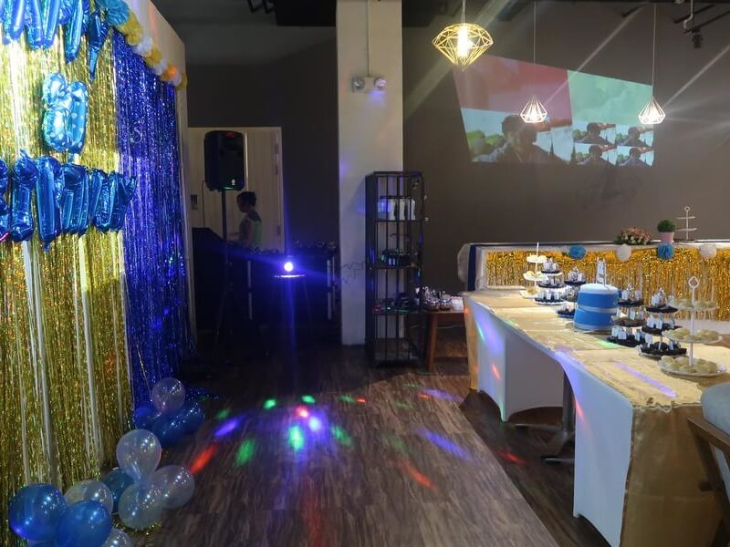 Birthday set up with cakes and photoshoot and projector screening photos