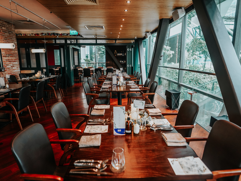 dining area with tables and chairs in restaurant for solemnisation