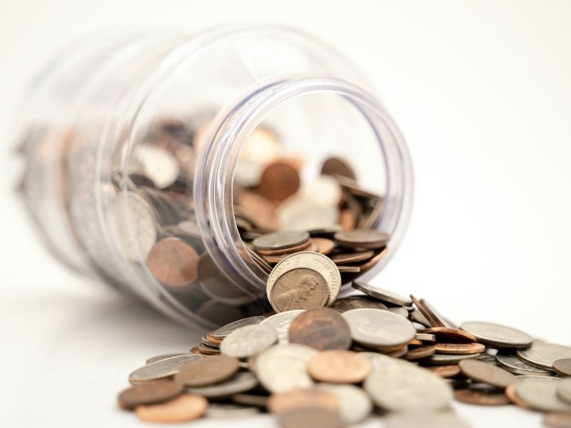 coins flowing out of jar