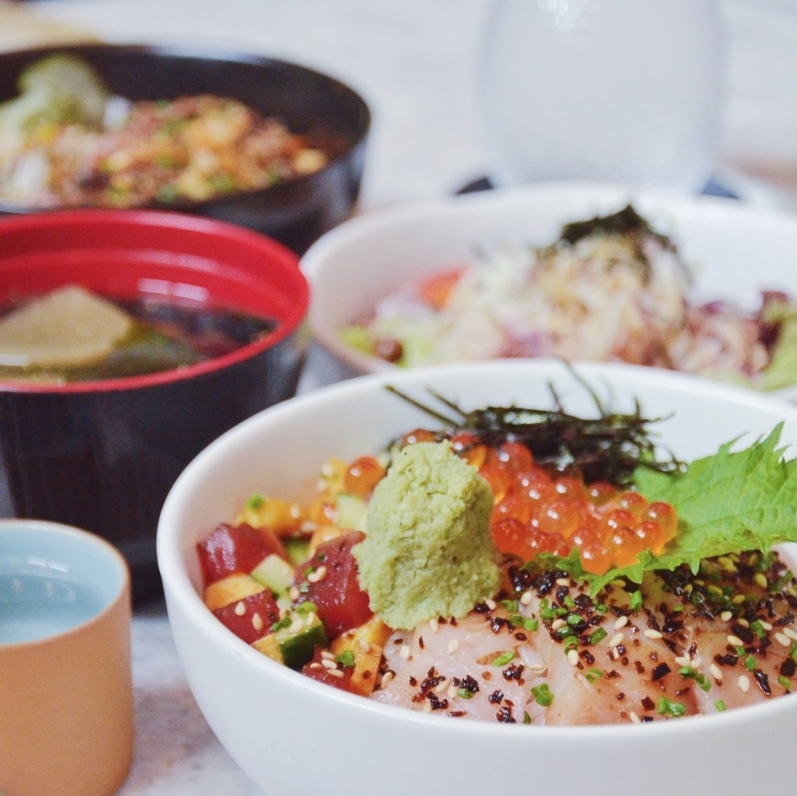 Variety of rice bowls laid out on a table
