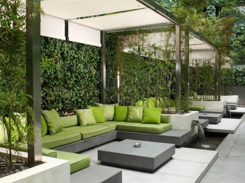 Green outdoors lounge area with wide seating spaces
