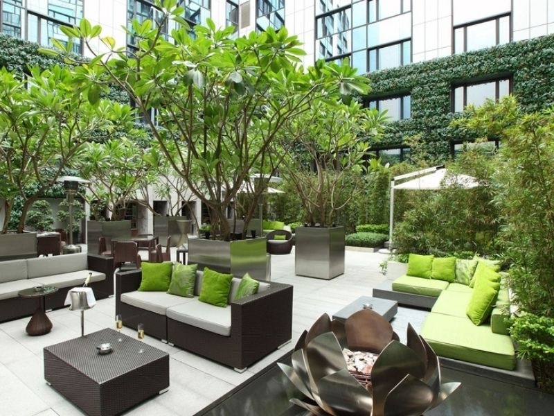 Wide outdoors seating area surrounded by trees