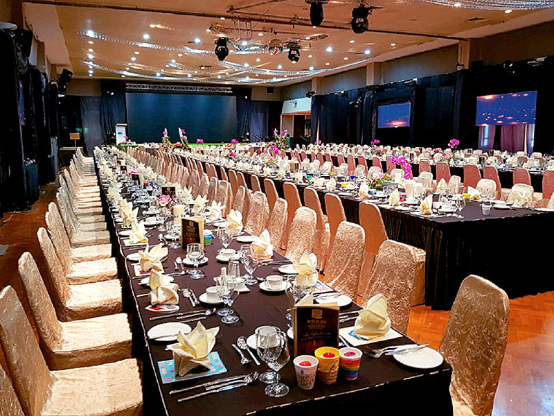 long tables and chairs in a function hall
