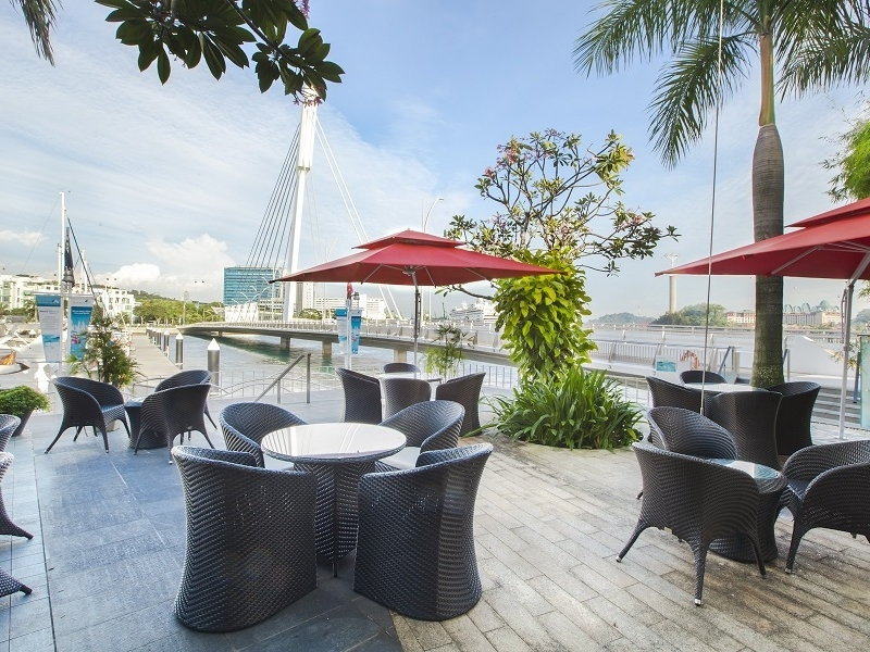 outdoor seating area by the sea