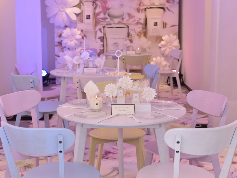 Jo Malone event set up with floral decor and furniture