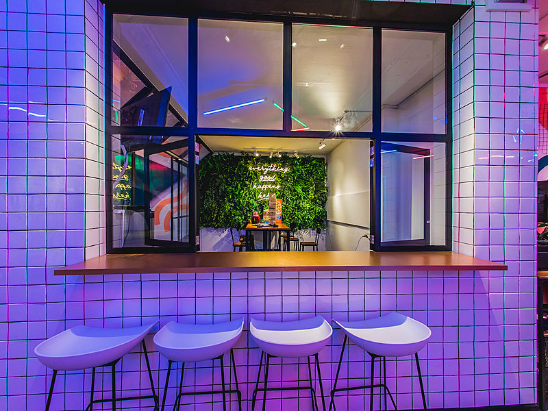 bar stools and window framing a seating area