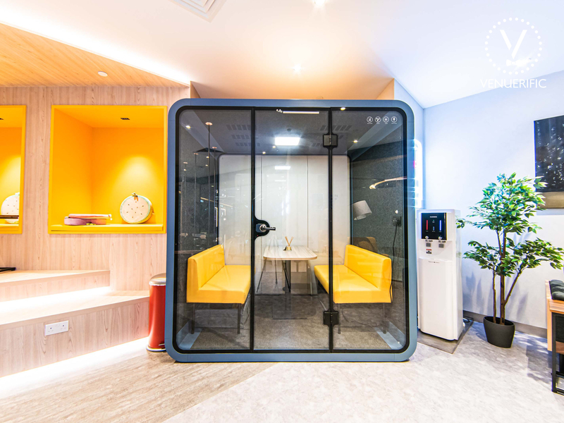 Box style booth with colourful bench seats for working