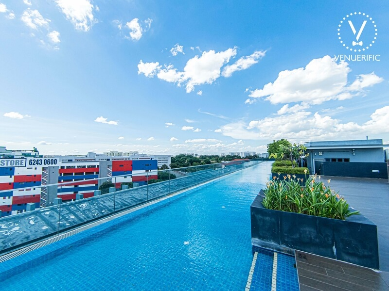 outdoor pool area with greenery