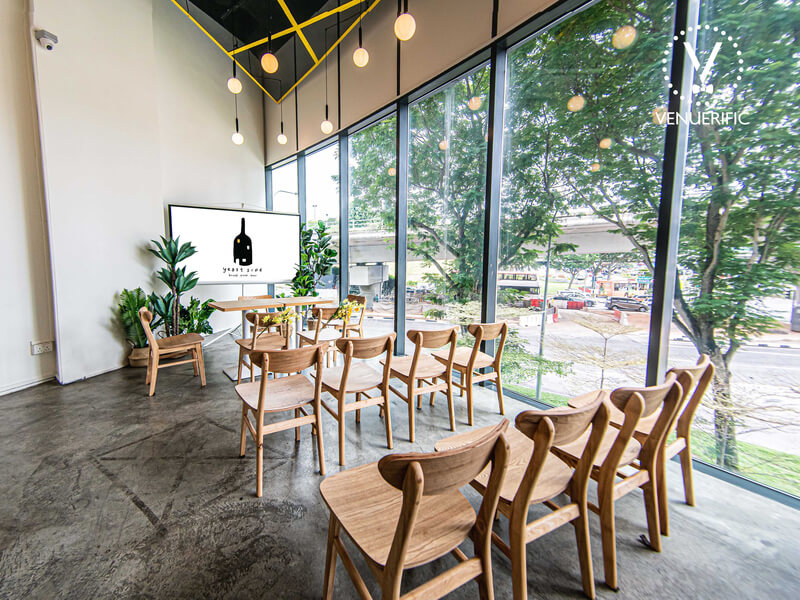 cafe with wooden chairs set up for event