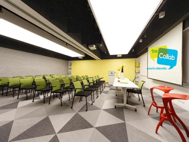 green chairs arranged for meeting