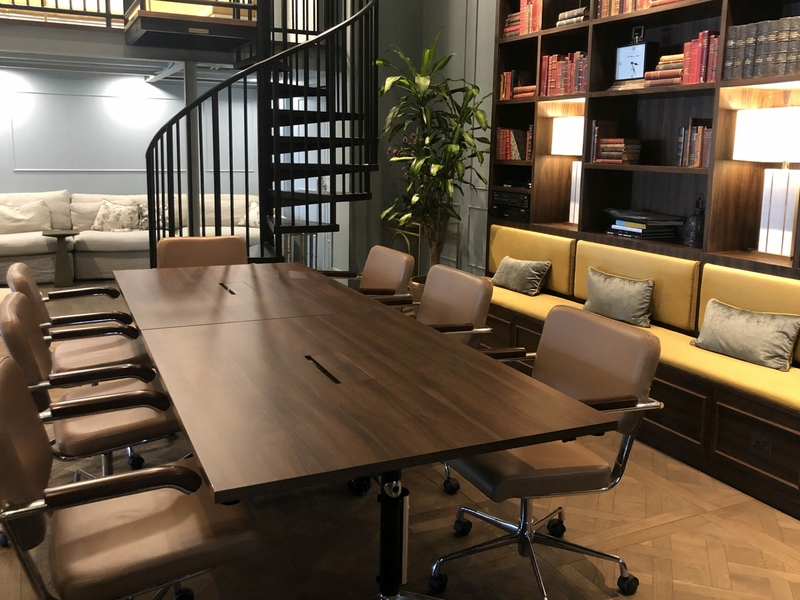 meeting room with book shelves and spiral staircase