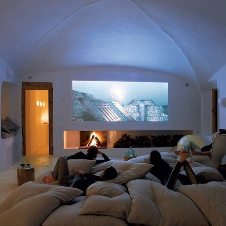 photo showing people watching a movie comfortably on a projector screen