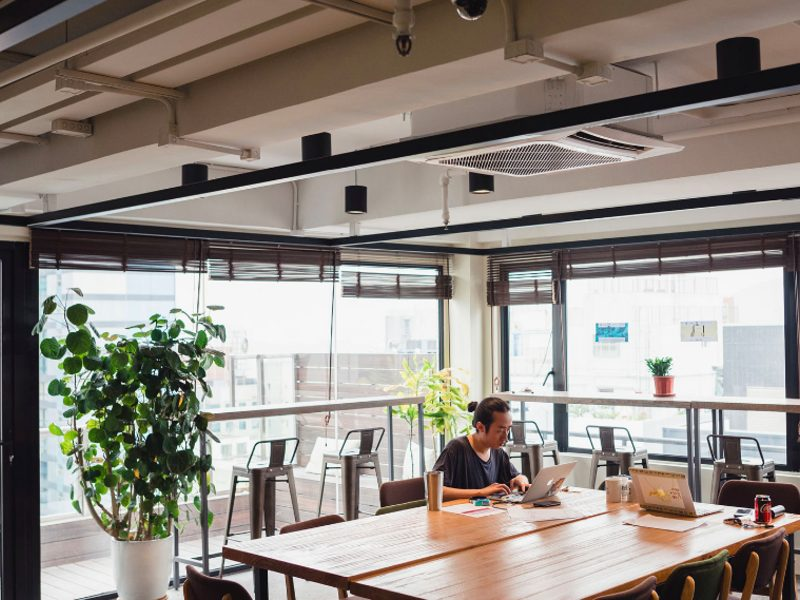 man working in co working space