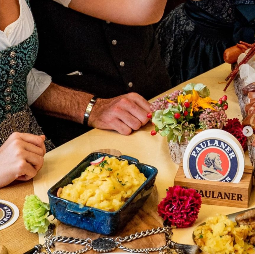 dining table with german foods and decorations