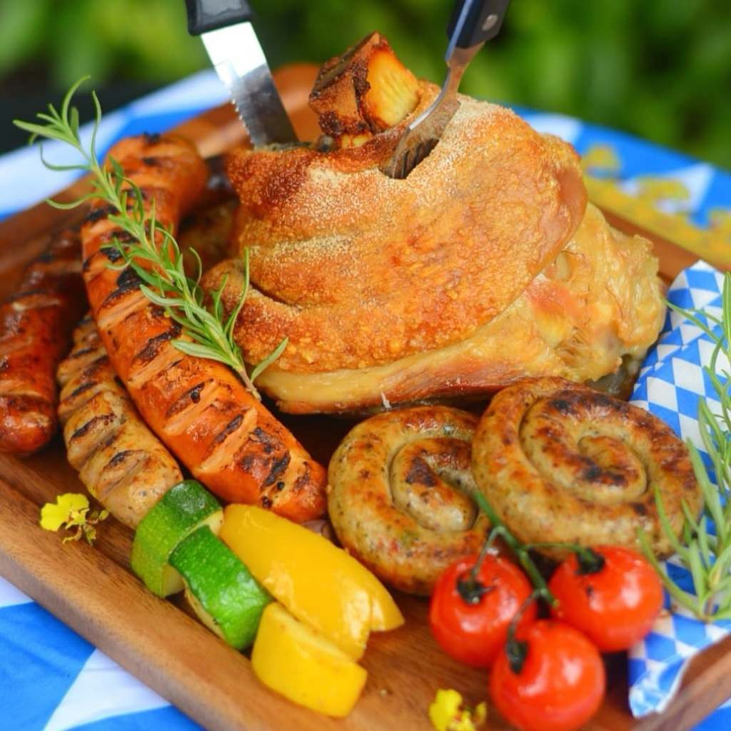 pork knuckle and different types of sausages