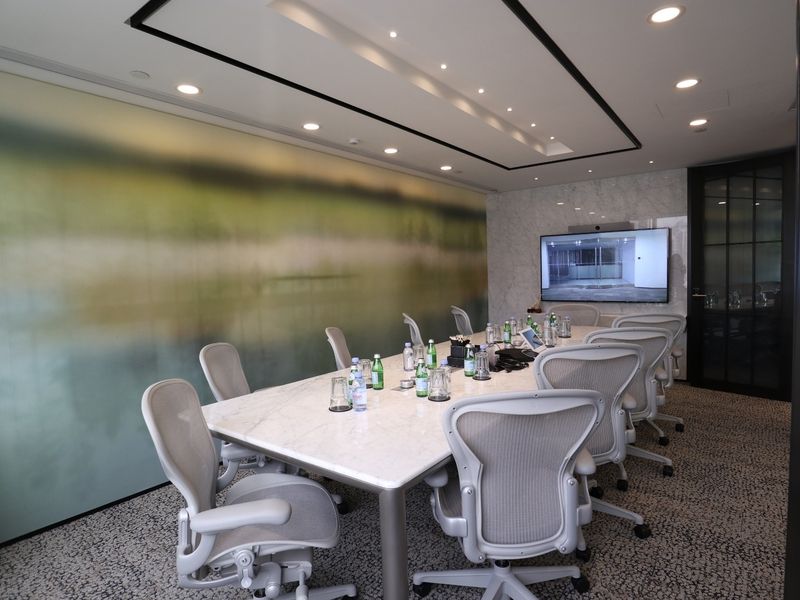 meeting room with grey chairs and tv