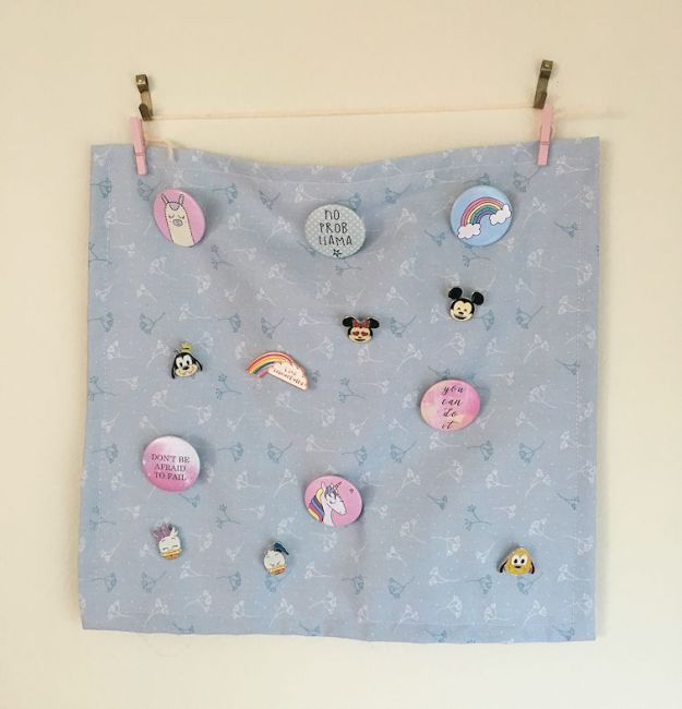 a wall hanging with various badges on it