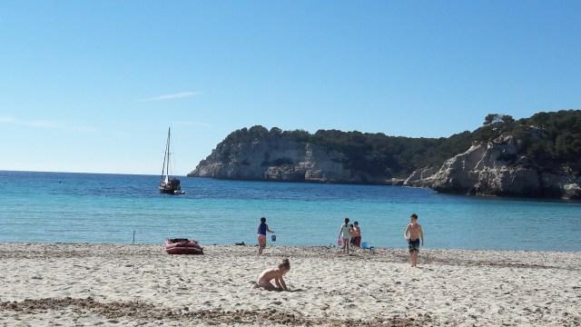 Family and friends playing on Cala Galdana beach