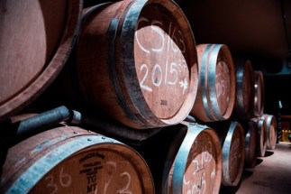 pile-of-brown-wooden-barrels-2440529