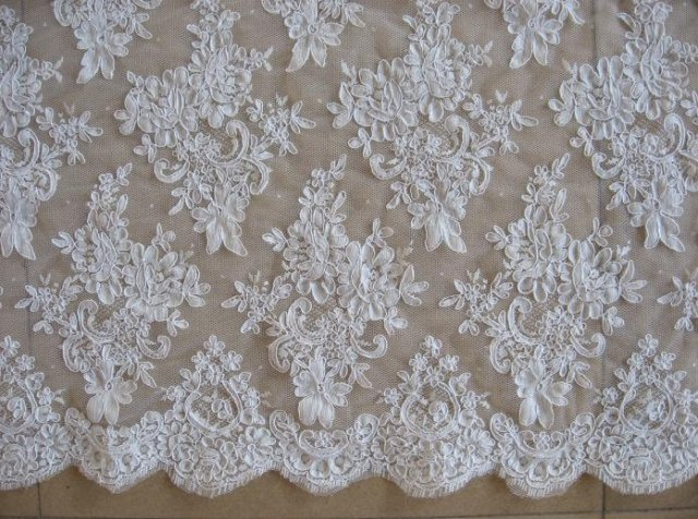A French needlepoint lace with a floral design.