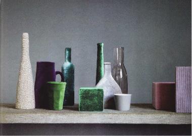 Bottles, vases and even glasses covered in velvet, how original - via Elle Decor