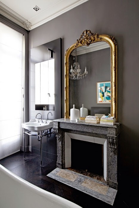 Dark walls in the bathroom, very chic in a Parisian appartment - via Habitually Chic